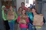girls deliver food to HoseaHouse