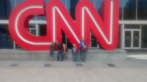 The kids pose in front of CNN